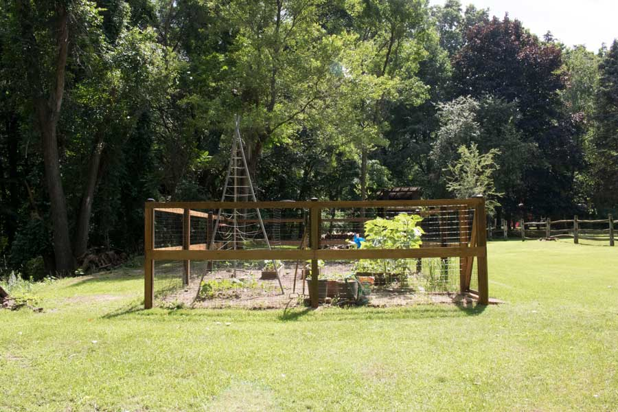 After: Custom wooden garden fence.