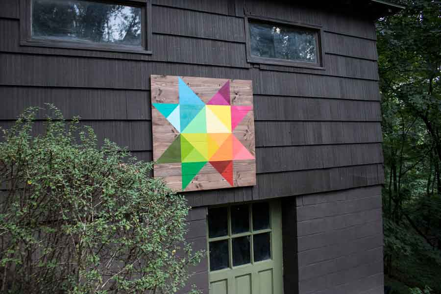 A handmade, hand-painted barn quilt made featuring modern, vivid colors / diy network