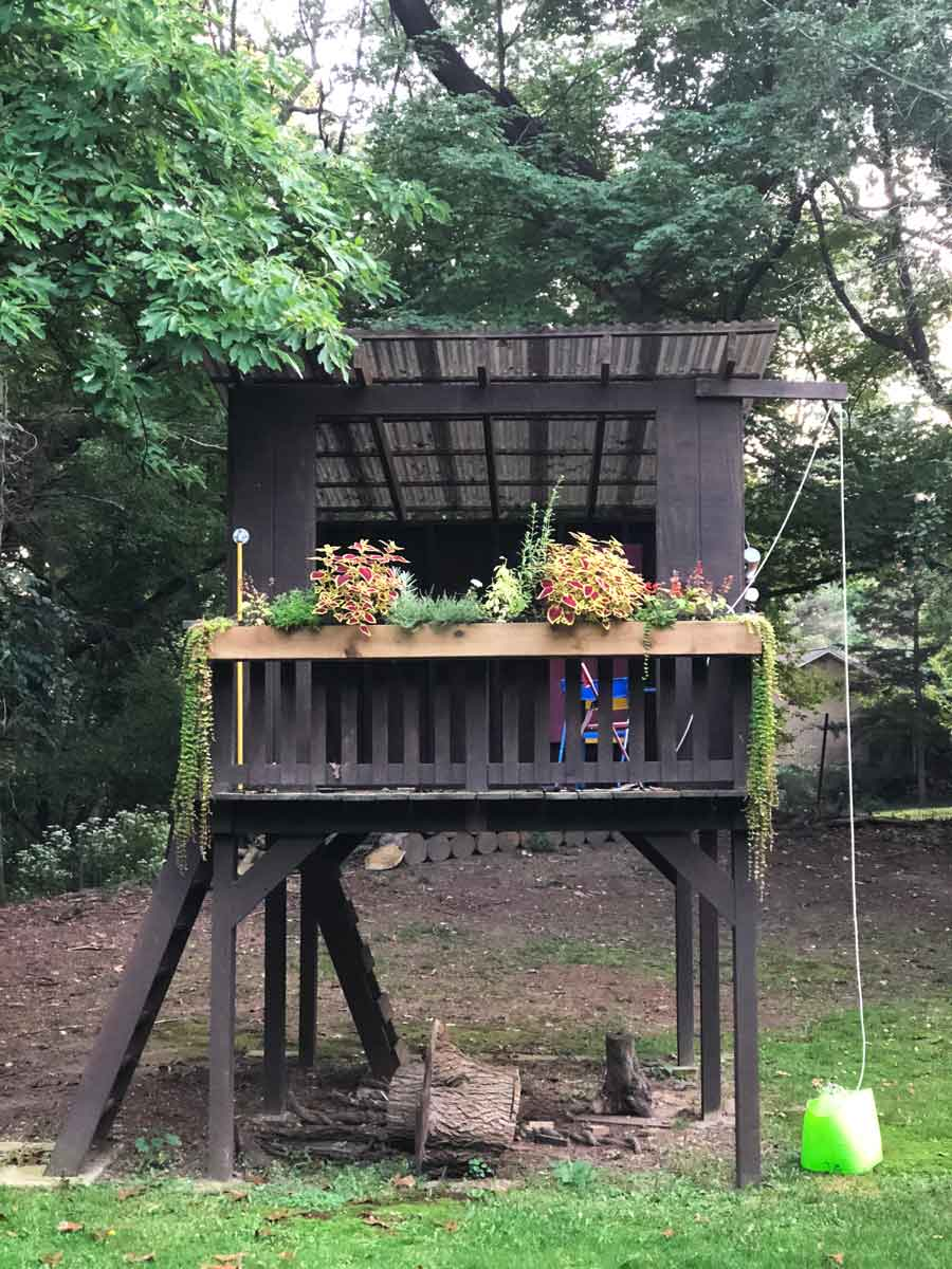 A DIY 8-foot long planter box mounted to our kid's treehouse.