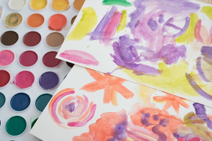 Watercolor patterns that will be used to make a rainbow flower paper headband for springtime.