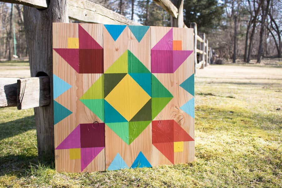 DIY barn quilt with modern rainbow design.