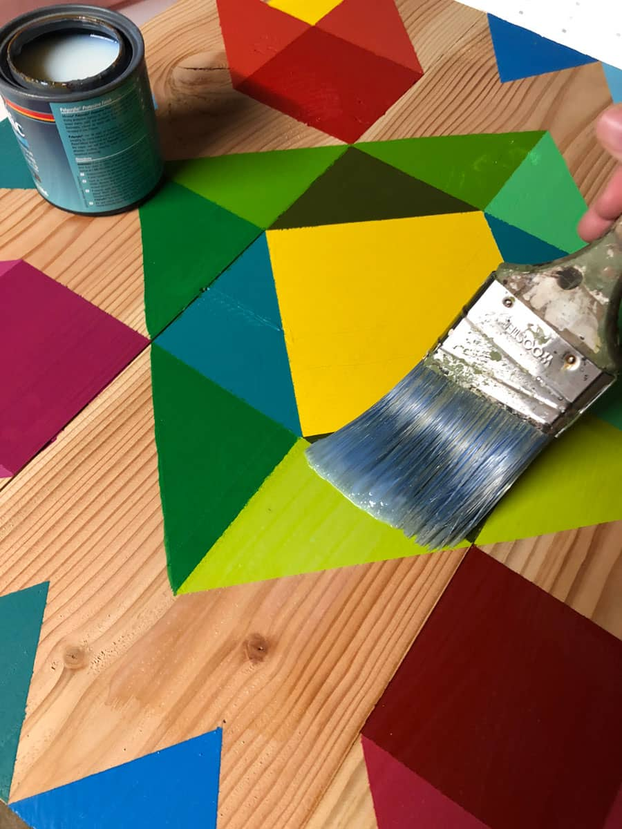 Water-based polyurethane to seal and protect a handmade barn quilt design.