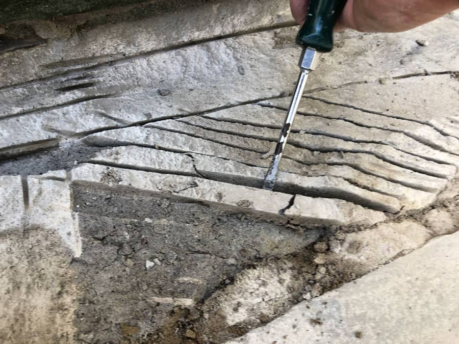 Using the STIHL TSA 230 to score mortar to make it easier to remove during a flagstone stair repair.
