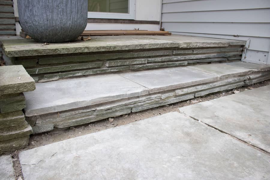 Repaired flagstone stairs on a 1950s home.