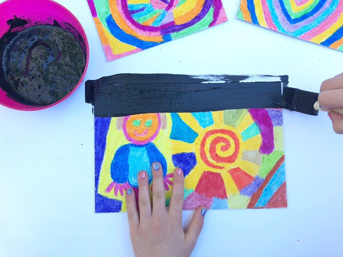 Make your own scratch art board with soapy acrylic paint dried atop crayon.