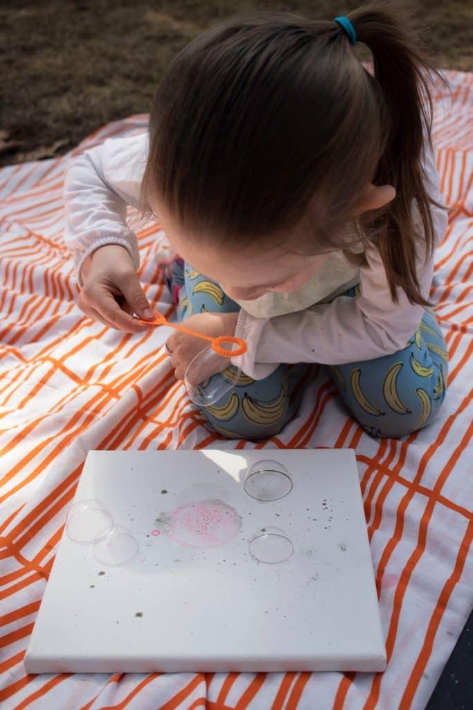 Blow dye bubbles to make your own artwork.