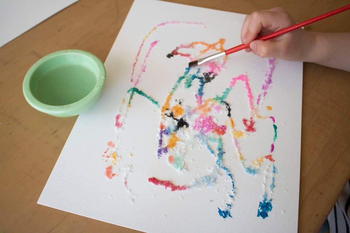 Kids love DIY salt art because it involves glue, sprinkling salt, and watercoloring.