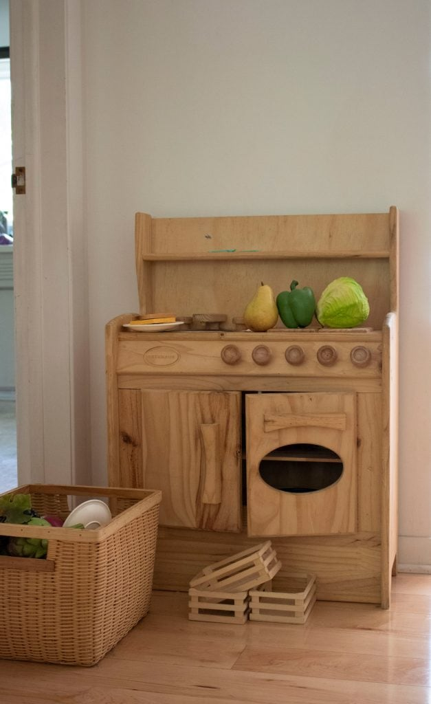 Wooden play kitchen, unfinished natural wood.